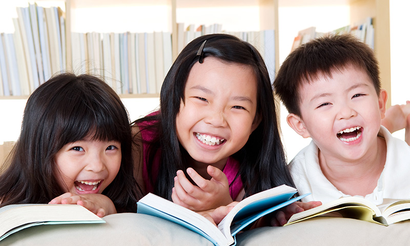 Asian kids laughing