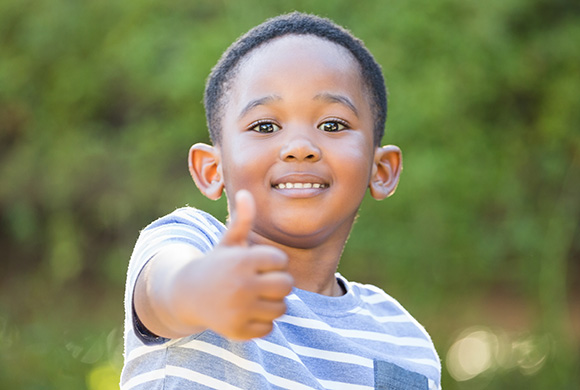 Boy with thumbs-up